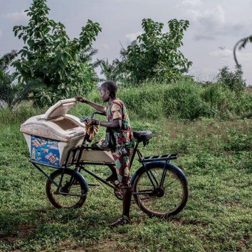 David Wagnières Photo of an Indigenous man on a bike