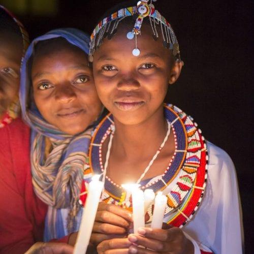 Maasai Girls Holding a Candle